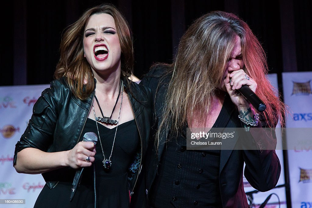 Vocalist / guitarist Lzzy Hale of Halestorm (L) and vocalist <a gi-track='captionPersonalityLinkClicked' href=/galleries/search?phrase=Sebastian+Bach&family=editorial&specificpeople=583692 ng-click='$event.stopPropagation()'>Sebastian Bach</a> of Skid Row perform at the Revolver Golden Gods Awards press conference at Hard Rock Cafe - Hollywood on January 30, 2013 in Hollywood, California.