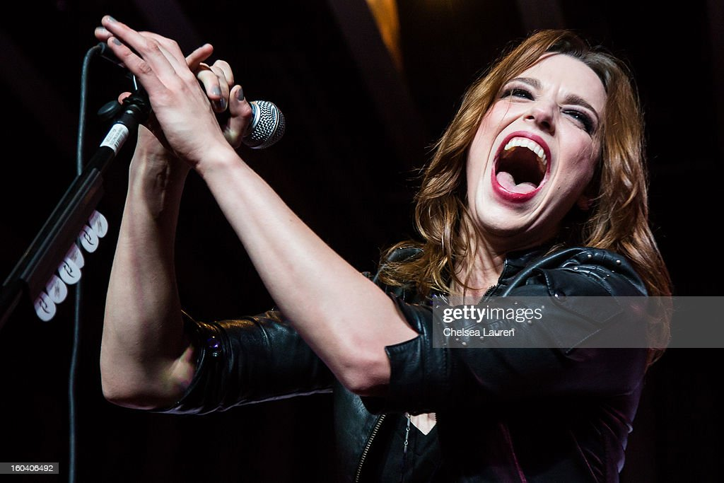 Vocalist / guitarist Lzzy Hale of Halestorm performs at the Revolver Golden Gods Awards press conference at Hard Rock Cafe - Hollywood on January 30, 2013 in Hollywood, California.