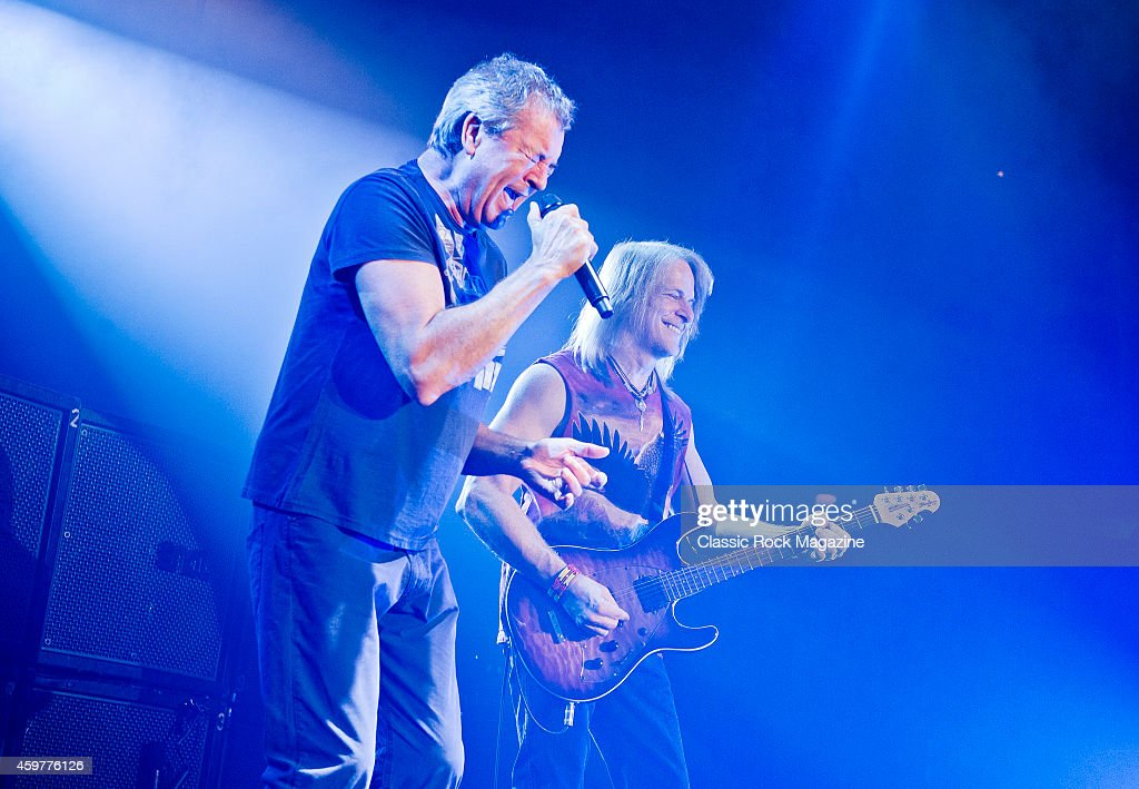 Vocalist Ian Gillan (L) and guitarist Steve Morse of English rock group Deep Purple performing live on stage at The Roundhouse in London, on October 17, 2013.