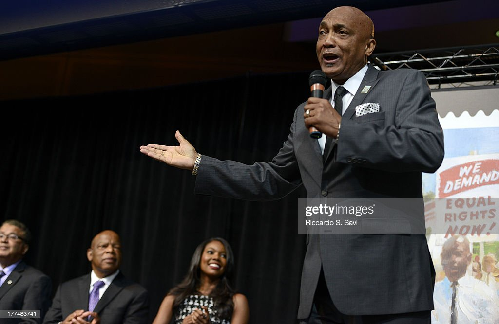Vocalist Joe Coleman sings during the unveiling of the 1963 March on Washington stamp on August 23, 2013 in Washington, United States.