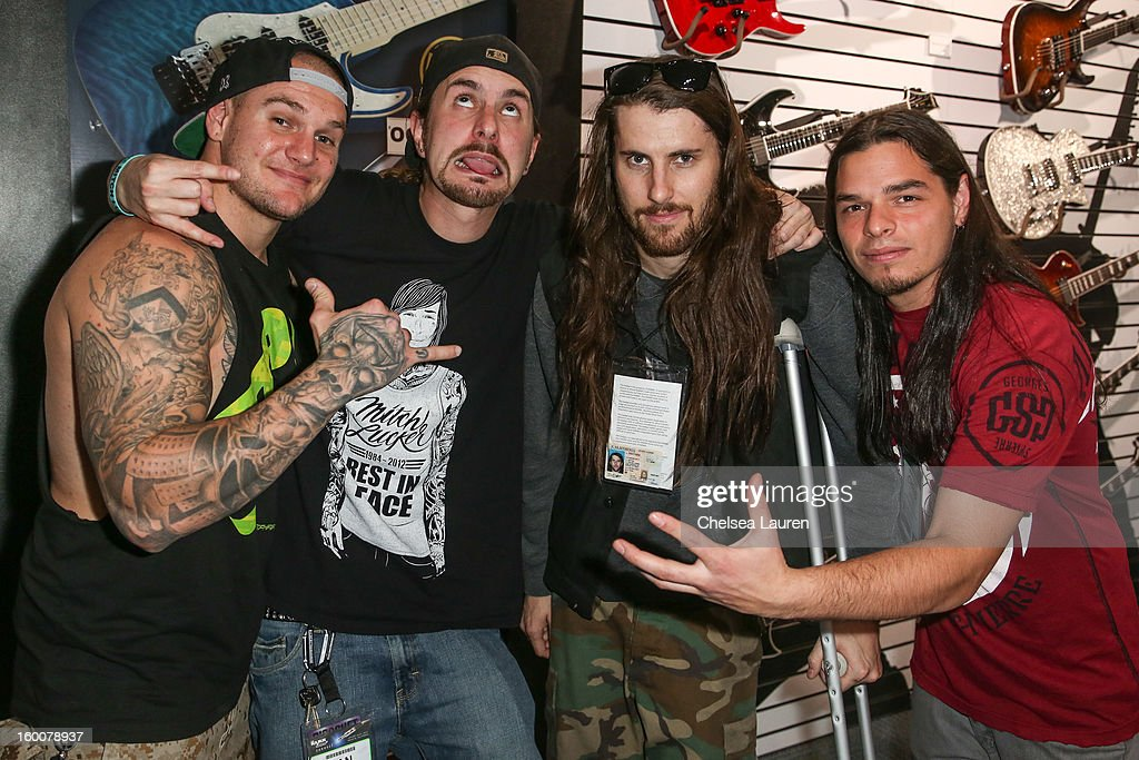 Vocalist Johnny Plague of Winds of Plague, bassist Dan Kenny of Suicide Silence, bassist David Sittig of Impending Doom and guitarist Chris Garza of Suicide Silence attend the 2013 NAMM show at Anaheim Convention Center on January 25, 2013 in Anaheim, California.