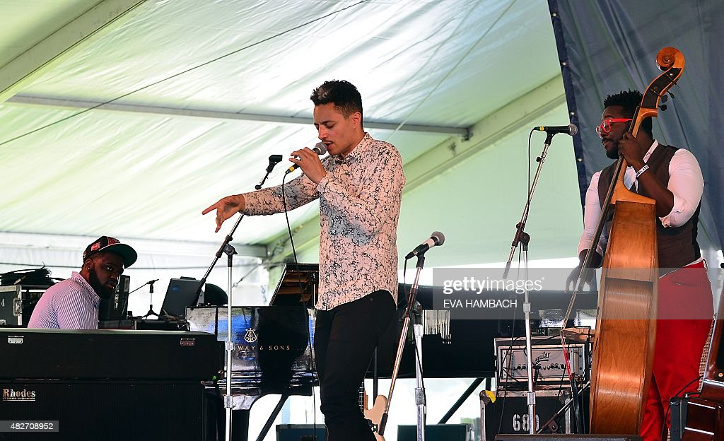 Vocalist <a gi-track='captionPersonalityLinkClicked' href=/galleries/search?phrase=Jos%C3%A9+James&family=editorial&specificpeople=14698698 ng-click='$event.stopPropagation()'>José James</a> performs with bassist Solomon Dorsey (R) at the Newport Jazz Festival in Newport, Rhode Island, on August 1, 2015. AFP PHOTO/ Eva HAMBACH