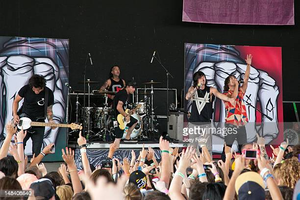 Vocalist Kellin Quinn of Sleeping with Sirens joins Pierce the Veil onstage during the 2012 Vans Warped Tour at Klipsch Music Center on July 10 2012...
