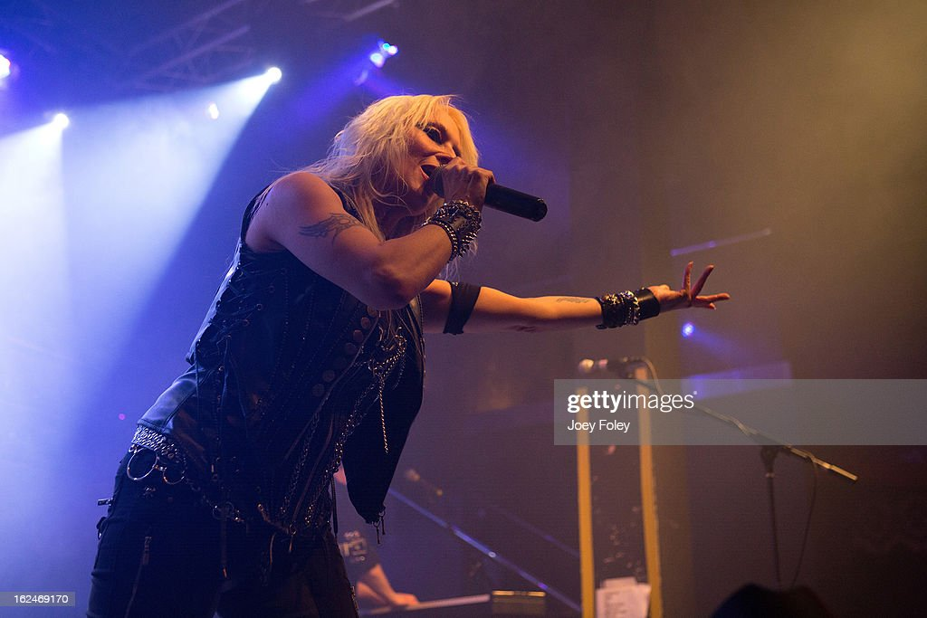 German hard rock vocalist, Doro Pesch of DORO performs in concert at Mojoes on February 13, 2013 in Joliet, Illinois. (Photo by Joey Foley/Getty Images) JOLIET, IL - FEBRUARY 13: Vocalist Liv Jagrell of Sister Sin performs in concert at Mojoes on February 13, 2013 in Joliet, Illinois.