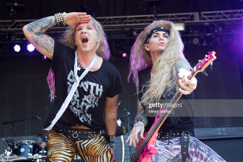 Vocalist Michael Starr and bassist Lexi Foxx of Steel Panther perform in Monster Energy's Aftershock Festival at Discovery Park on September 14, 2013 in Sacramento, California.
