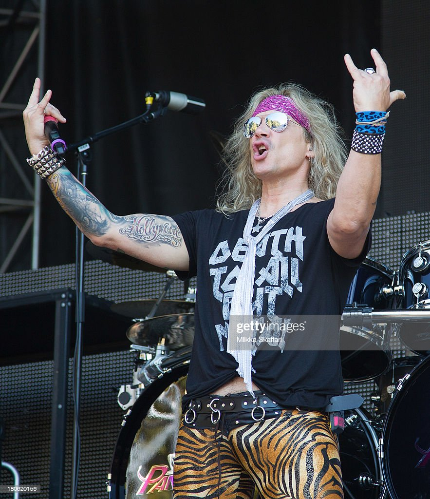 Vocalist Michael Starr of Steel Panther performs in Monster Energy's Aftershock Festival at Discovery Park on September 14, 2013 in Sacramento, California.