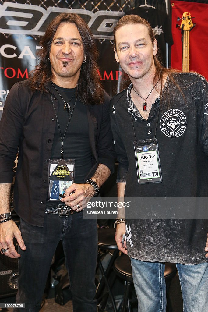 Vocalist Michael Sweet (L) and bassist Tim Gaines of Stryper attend the 2013 NAMM show at Anaheim Convention Center on January 25, 2013 in Anaheim, California.