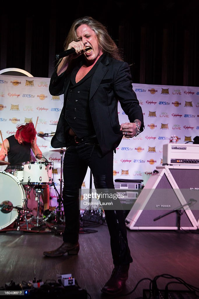 Vocalist <a gi-track='captionPersonalityLinkClicked' href=/galleries/search?phrase=Sebastian+Bach&family=editorial&specificpeople=583692 ng-click='$event.stopPropagation()'>Sebastian Bach</a> of Skid Row performs at the Revolver Golden Gods Awards press conference at Hard Rock Cafe - Hollywood on January 30, 2013 in Hollywood, California.