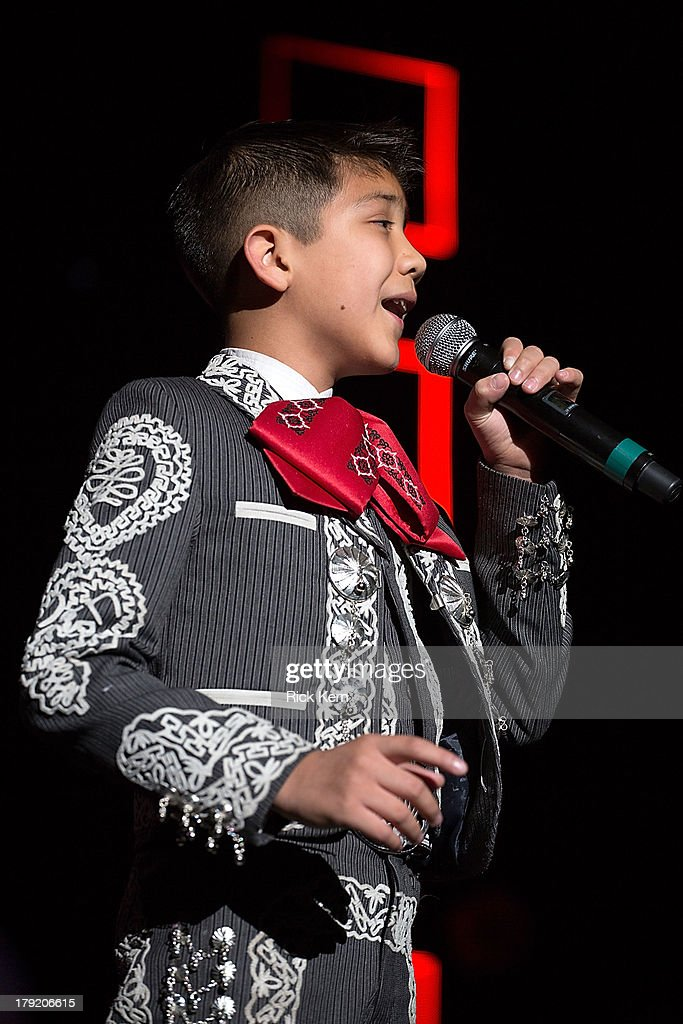 Vocalist <a gi-track='captionPersonalityLinkClicked' href=/galleries/search?phrase=Sebastien+de+la+Cruz&family=editorial&specificpeople=10988277 ng-click='$event.stopPropagation()'>Sebastien de la Cruz</a> performs in concert as part of Festival People en Español Presented by Target at The Alamodome on August 31, 2013 in San Antonio, Texas.