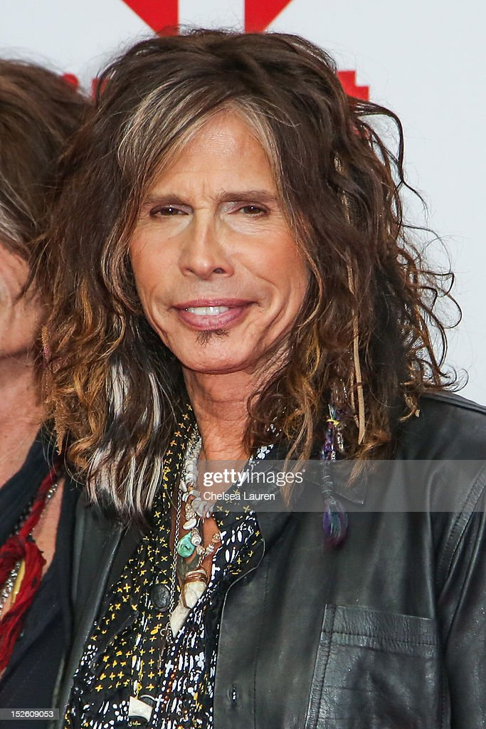 Vocalist <a gi-track='captionPersonalityLinkClicked' href=/galleries/search?phrase=Steven+Tyler+-+Musician&family=editorial&specificpeople=202080 ng-click='$event.stopPropagation()'>Steven Tyler</a> of Aerosmith arrives at iHeartRadio Music Festival press room at MGM Grand Garden Arena on September 22, 2012 in Las Vegas, Nevada.