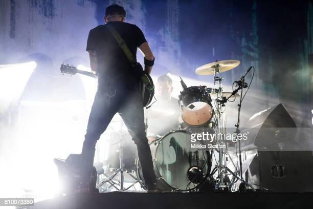 Vocalist Tim McIlrath and drummer Brandon Barnes of Rise Against perform at Concord Pavilion on July 6 2017 in Concord California