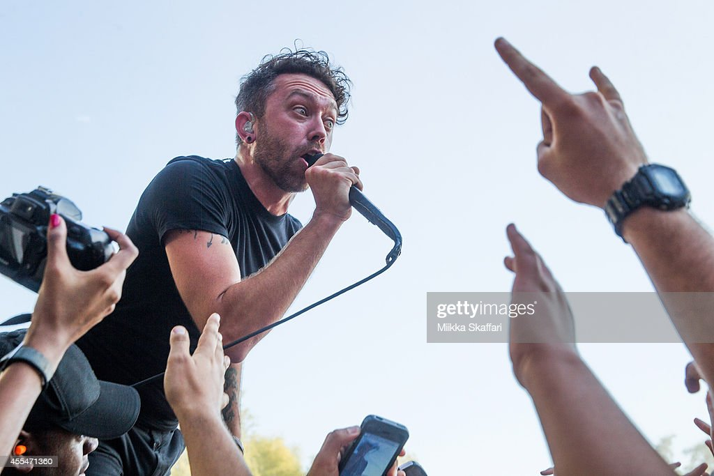 Vocalist Tim McIlrath of Rise Against performs at Aftershock Festival at Discovery Park on September 14 2014 in Sacramento California