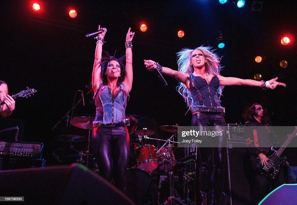 Vocalists Carla Harvey and Heidi Shepherd of Butcher Babies performs onstage at Bogart's on January 19, 2013 in Cincinnati, Ohio.