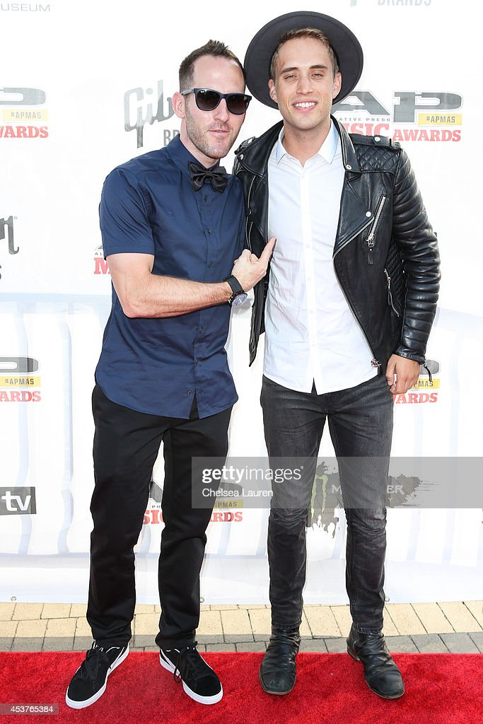 Vocalists <a gi-track='captionPersonalityLinkClicked' href=/galleries/search?phrase=Chuck+Comeau&family=editorial&specificpeople=215359 ng-click='$event.stopPropagation()'>Chuck Comeau</a> of Simple Plan (L) and Brian Logan Dales of The Summer Set attend the 2014 Gibson Brands AP Music Awards at the Rock and Roll Hall of Fame and Museum on July 21, 2014 in Cleveland, Ohio.