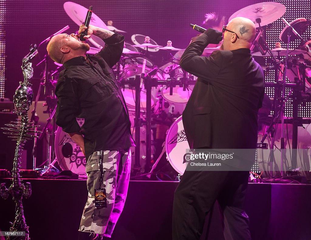 Vocalists Ivan Moody of Five Finger Death Punch (L) and <a gi-track='captionPersonalityLinkClicked' href=/galleries/search?phrase=Rob+Halford&family=editorial&specificpeople=209090 ng-click='$event.stopPropagation()'>Rob Halford</a> of Judas Priest perform at the 5th annual Revolver Golden Gods award show at Club Nokia on May 2, 2013 in Los Angeles, California.