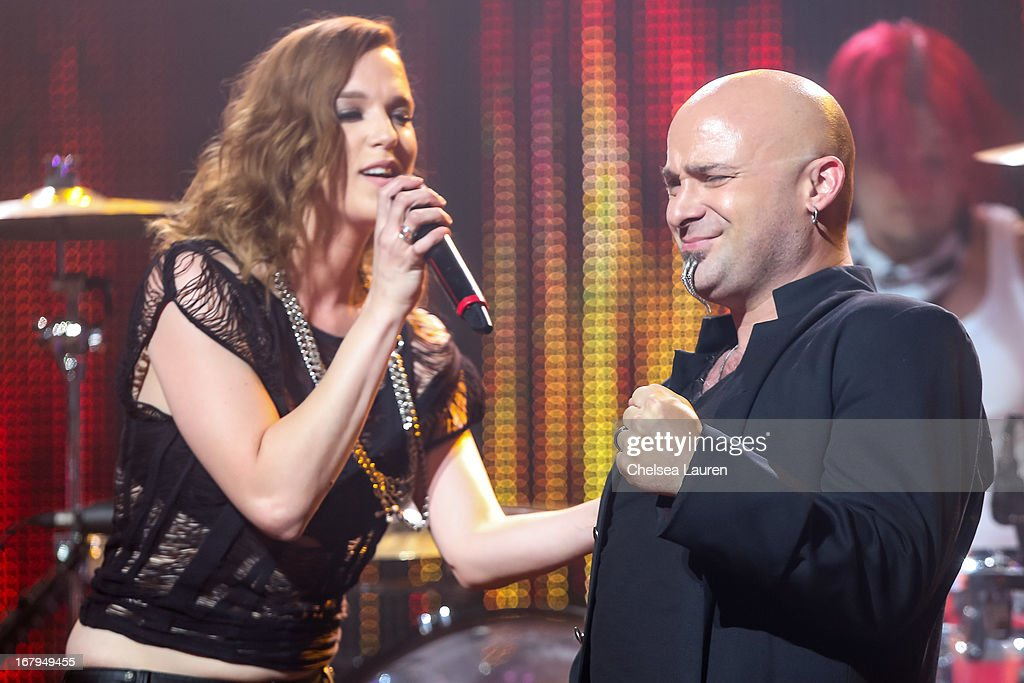 Vocalists Lzzy Hale of Halestorm (L) and David Draiman of Disturbed / Device perform at the 5th annual Revolver Golden Gods award show at Club Nokia on May 2, 2013 in Los Angeles, California.
