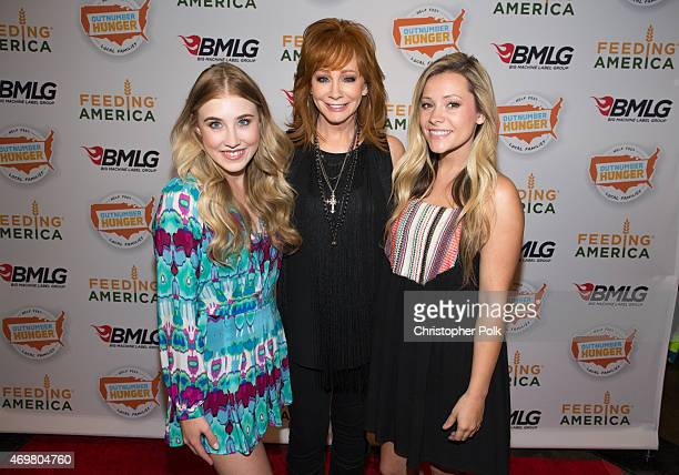 Vocalists Madison Marlow and Taylor Dye of the musical duo Maddie and Tae pose with entertainer Reba McEntire at the 'Reba and Friends Outnumber...