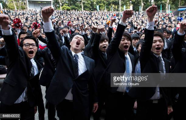 Vocational school students raise their fists during a rally to kick off jobhunting on March 1 2017 in Tokyo Japan About 1500 students from 11 schools...