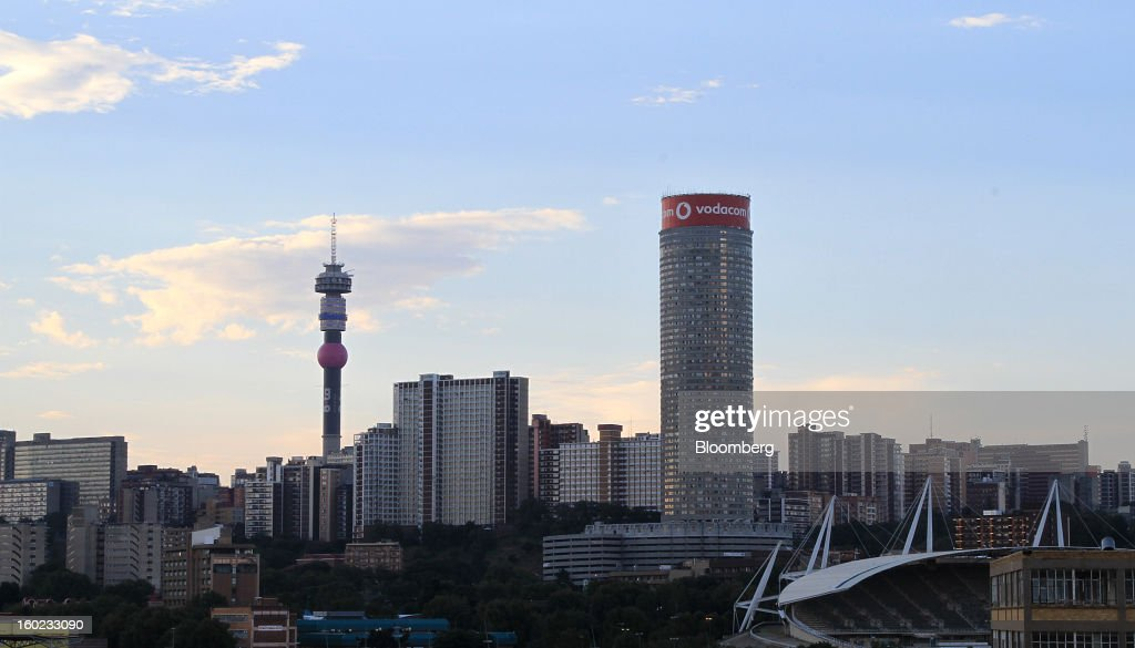 A Vodacom Group Ltd. advertisement is seen atop the Ponte tower, right, on the skyline of Johannesburg, South Africa, on Monday, January 28, 2013. Almost two decades after Vodafone Group Plc entered Africa, the region -- where most people earn less than $2 a day and mobile phone towers run on diesel -- is turning into one of the company's biggest profit generators. Photographer: Nadine Hutton/Bloomberg via Getty Images