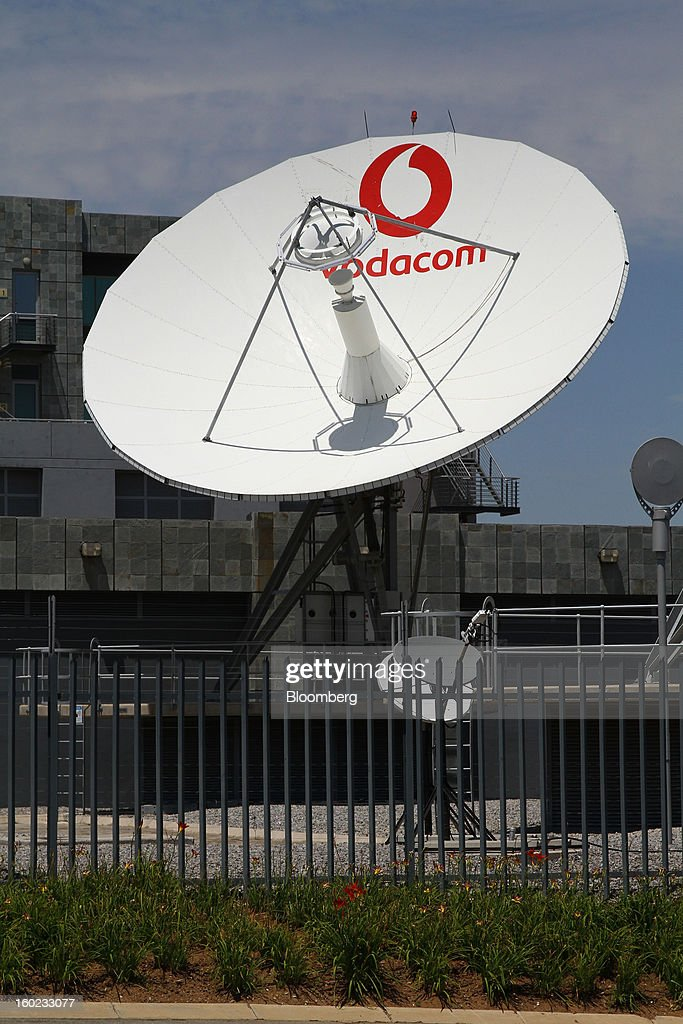A Vodacom-branded satellite dish stands outside the headquarters of Vodacom Group Ltd., Vodafone's biggest African business, in Johannesburg, South Africa, on Monday, January 28, 2013. Almost two decades after Vodafone Group Plc entered Africa, the region -- where most people earn less than $2 a day and mobile phone towers run on diesel -- is turning into one of the company's biggest profit generators. Photographer: Nadine Hutton/Bloomberg via Getty Images