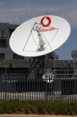 A Vodacombranded satellite dish stands outside the headquarters of Vodacom Group Ltd Vodafone's biggest African business in Johannesburg South Africa...