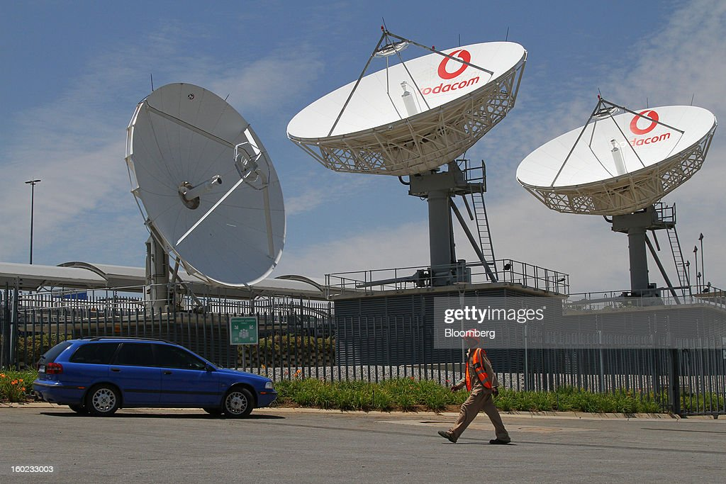 Vodacom-branded satellite dishes stand outside the headquarters of Vodacom Group Ltd., Vodafone's biggest African business, in Johannesburg, South Africa, on Monday, January 28, 2013. Almost two decades after Vodafone Group Plc entered Africa, the region -- where most people earn less than $2 a day and mobile phone towers run on diesel -- is turning into one of the company's biggest profit generators. Photographer: Nadine Hutton/Bloomberg via Getty Images
