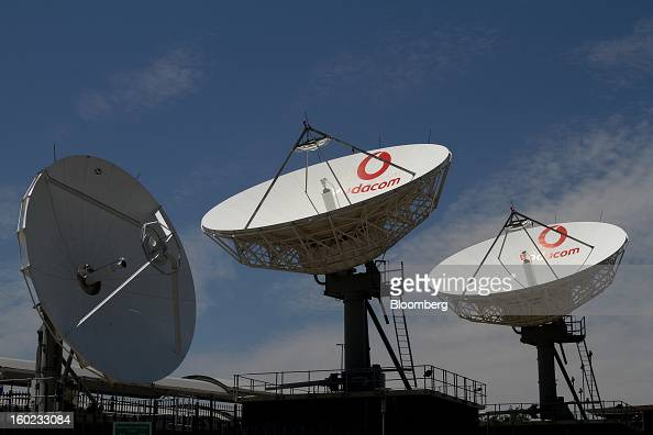 Vodacombranded satellite dishes stand outside the headquarters of Vodacom Group Ltd Vodafone's biggest African business in Johannesburg South Africa...