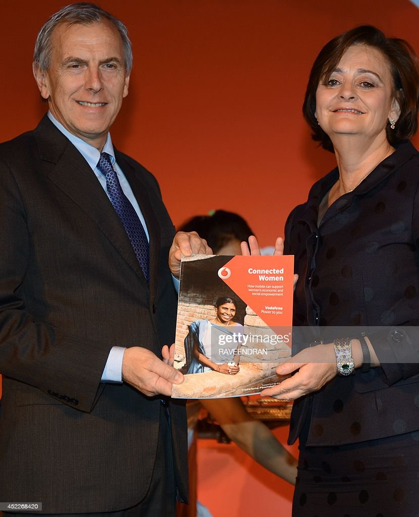 Vodafone CEO and Managing Director, Marten Pieters (L) and founder of the Cherie Blair Foundation for Women, Cherie Blair launch the Vodafaone Connected Women report 2014 in New Delhi on July 17, 2014. The Vodafone Connected Women report has found that providing women with greater access to mobile phones and services could lead to a 29 billion dollar increase in annual global productivity from 2020, as a result of geater female participation in the workforce and saving in public services.