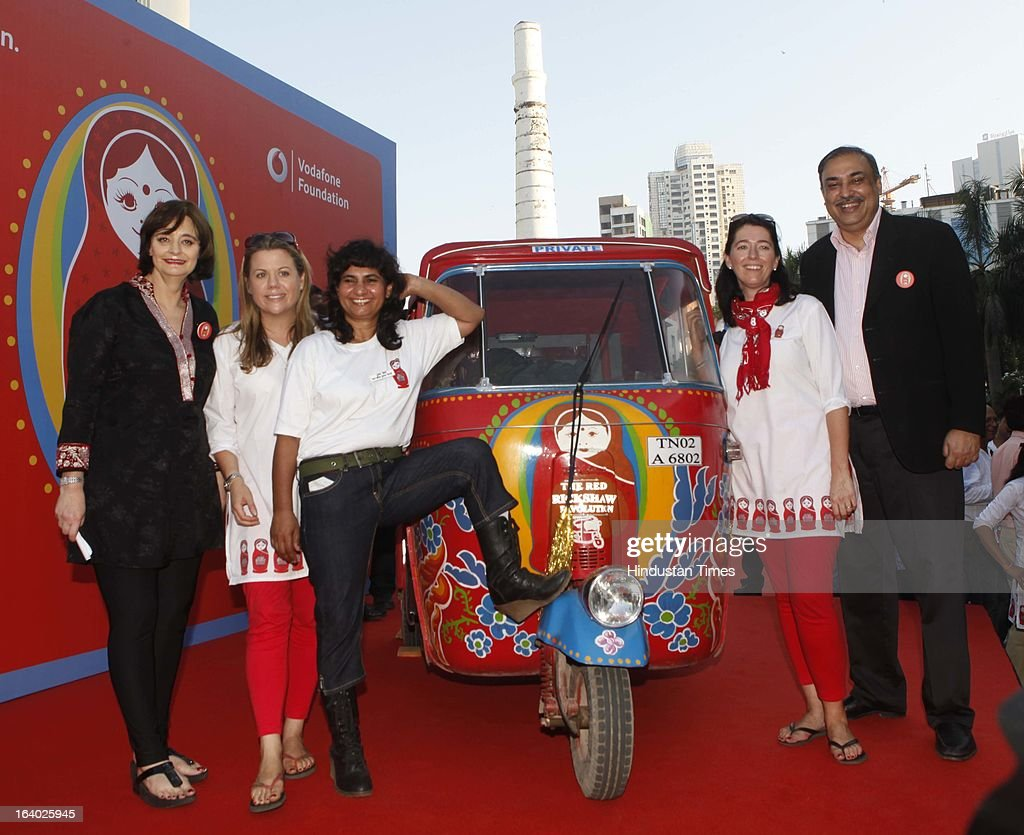 Vodafone Foundation's Red Rickshaw revolution ends in Mumbai, which raises Rs 1.3 crore for partner NGOs marking the successful completion of a 1500km journey from Delhi to Mumbai by Laura Turkington (Country Director, Vodafone Foundation India), Carina Deegan (Supporter, Vodafone Foundation India), Sunita Chaudhary (First Indian Female Rickshaw Driver) and Cherie Blair (Supporter, Vodafone Foundation India) on March 18, 2013 in Mumbai, India. The key objective of this initiative is to spread awareness, garner support and raise funds for NGOs working to empower several other such women. Digital Empowerment Foundation.