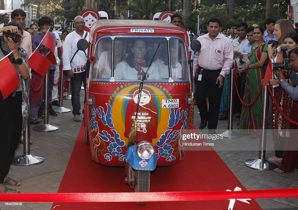 Vodafone Foundation's Red Rickshaw revolution ends in Mumbai, which raises Rs 1.3 crore for partner NGOs marking the successful completion of a 1500km journey from Delhi to Mumbai by Laura Turkington (Country Director, Vodafone Foundation India), Carina Deegan (Supporter, Vodafone Foundation India) and Sunita Chaudhary (First Indian Female Rickshaw Driver) on March 18, 2013 in Mumbai, India. The key objective of this initiative is to spread awareness, garner support and raise funds for NGOs working to empower several other such women. Digital Empowerment Foundation.