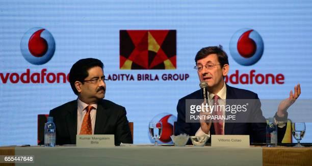 Vodafone Group CEO Vittorio Colao speaks as chairman of India's Aditya Birla Group Kumar Mangalam Birla watches during a news conference in Mumbai on...