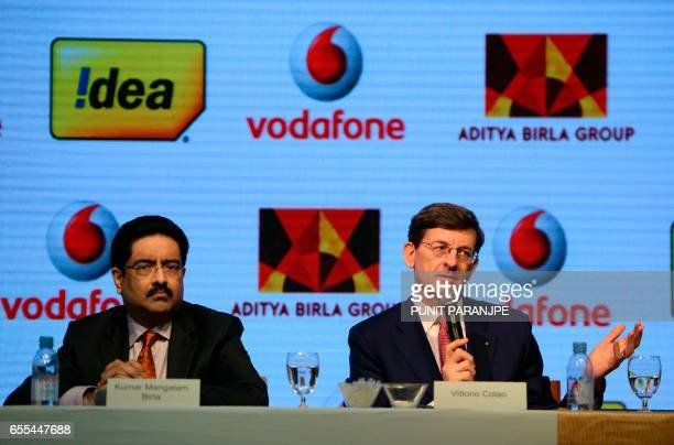 Vodafone Group CEO Vittorio Colao speaks as the chairman of India's Aditya Birla Group Kumar Mangalam Birla watches during a news conference in...