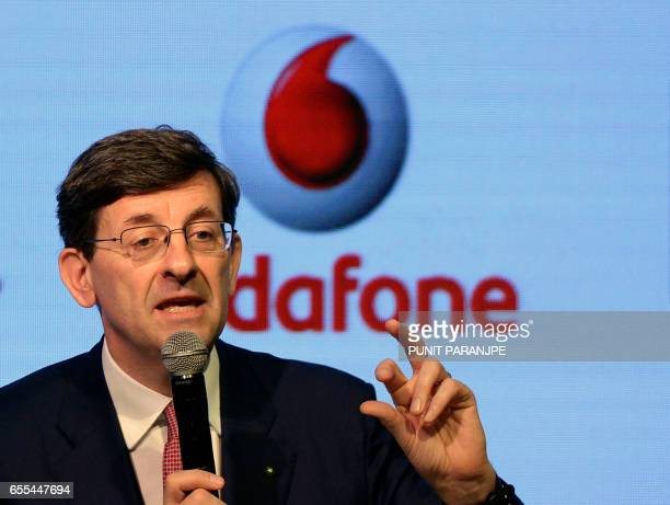 Vodafone Group CEO Vittorio Colao speaks during a news conference in Mumbai on March 20 2017 British mobile phone giant Vodafone's Indian unit will...