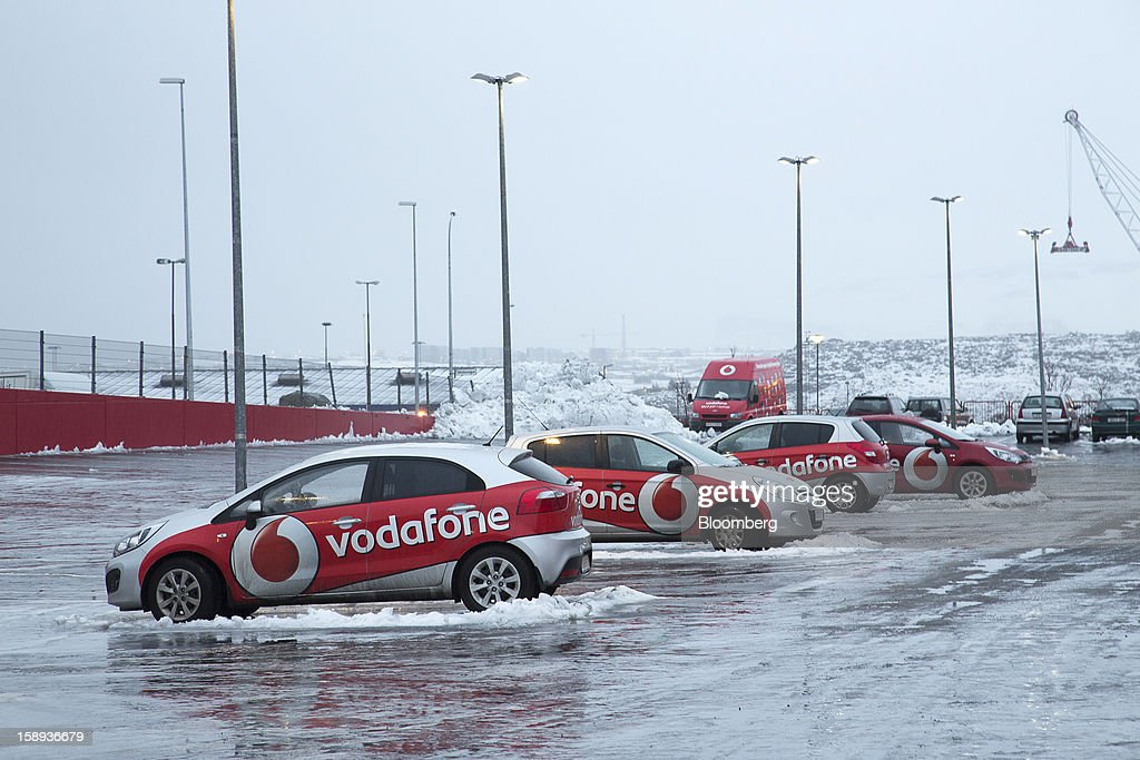 Vodafone Iceland Fjarskipti hf-branded vehicles stand outside the company's offices in Reykjavik, Iceland, on Wednesday, Jan. 2, 2013. Iceland's inflation rate eased in December as central bank efforts to stabilize the krona with interest rate increases paid off. Photographer: Arnaldur Halldorsson/Bloomberg via Getty Images