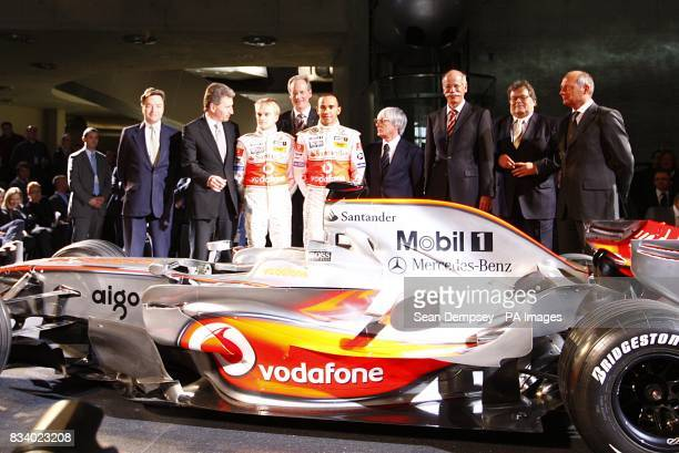 Vodafone McLaren Mercedes driver Lewis Hamilton and team mate Heikki Kovalainen with their management team during the launch of the Vodafone McLaren...