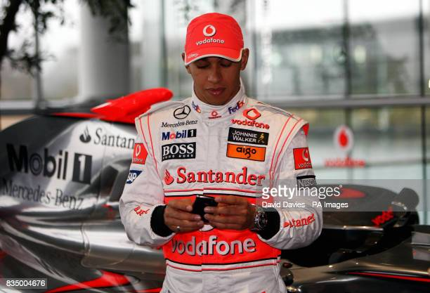 Vodafone McLaren Mercedes driver Lewis Hamilton checks his mobile phone during the McLaren Mercedes Formula One Launch at the Technology Centre in...