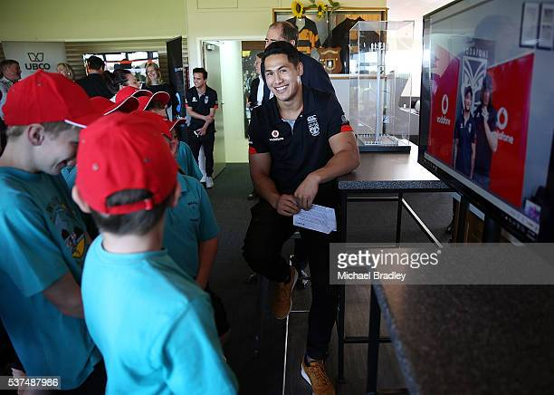 Vodafone Warrior Roger TuivasaSheck with kids from Waipu Primary School call the Vodafone Warriors back to Mt Smart Stadium during an event...