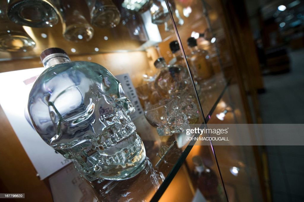 Vodka in a bottle shaped like a skull is on display at Berlin's iconic 'Kaufhaus des Westens' (usually abbreviated to 'KaDeWe' - literally 'Department Store of the West') on April 30, 2013. The department store, founded in 1907, and one of the largest in Europe, became a symbol of wealth and capitalist luxury during the Cold War in what was then West Berlin. AFP PHOTO / JOHN MACDOUGALL