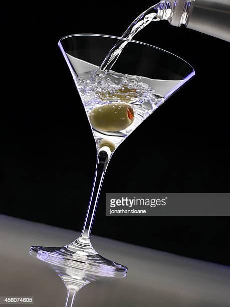 Vodka pouring into martini glass