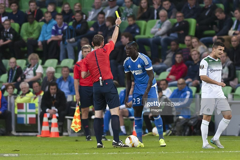 UEFA, Fc Groningen vs Olympique de Marseille,(L- R)Yevhen Aranovskiy referee,<a gi-track='captionPersonalityLinkClicked' href=/galleries/search?phrase=Benjamin+Mendy&family=editorial&specificpeople=7029850 ng-click='$event.stopPropagation()'>Benjamin Mendy</a> of Olympique de Marseille,Bryan Linssen of FC Groningen,gele kaart during the UEFA Europa League match between FC Groningen and Olympique Marseille on September 17, 2015 at the Euroborg stadium in Groningen, The Netherlands.
