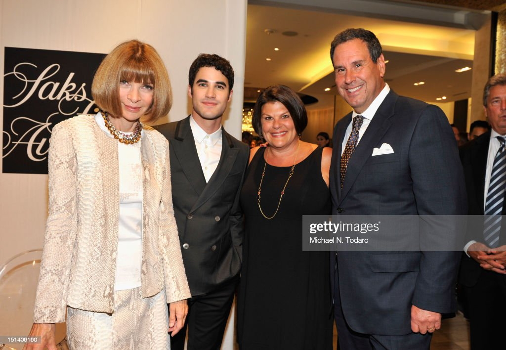 Vogue Editor-in-Chief <a gi-track='captionPersonalityLinkClicked' href=/galleries/search?phrase=Anna+Wintour&family=editorial&specificpeople=202210 ng-click='$event.stopPropagation()'>Anna Wintour</a>, actor <a gi-track='captionPersonalityLinkClicked' href=/galleries/search?phrase=Darren+Criss&family=editorial&specificpeople=7341435 ng-click='$event.stopPropagation()'>Darren Criss</a>, Karin Sadove, and Chairman and CEO of Saks Fifth Avenue Stephen Sadove attend Fashion's Night Out at Saks Fifth Avenue on September 6, 2012 in New York City.