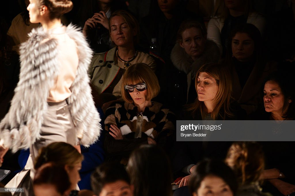 Vogue Editor-in-chief <a gi-track='captionPersonalityLinkClicked' href=/galleries/search?phrase=Anna+Wintour&family=editorial&specificpeople=202210 ng-click='$event.stopPropagation()'>Anna Wintour</a> and Vogue Fashion Market/Accessories Director <a gi-track='captionPersonalityLinkClicked' href=/galleries/search?phrase=Virginia+Smith&family=editorial&specificpeople=220533 ng-click='$event.stopPropagation()'>Virginia Smith</a> attend the Carolina Herrera Fall 2013 fashion show during Mercedes-Benz Fashion Week at The Theatre at Lincoln Center on February 11, 2013 in New York City.