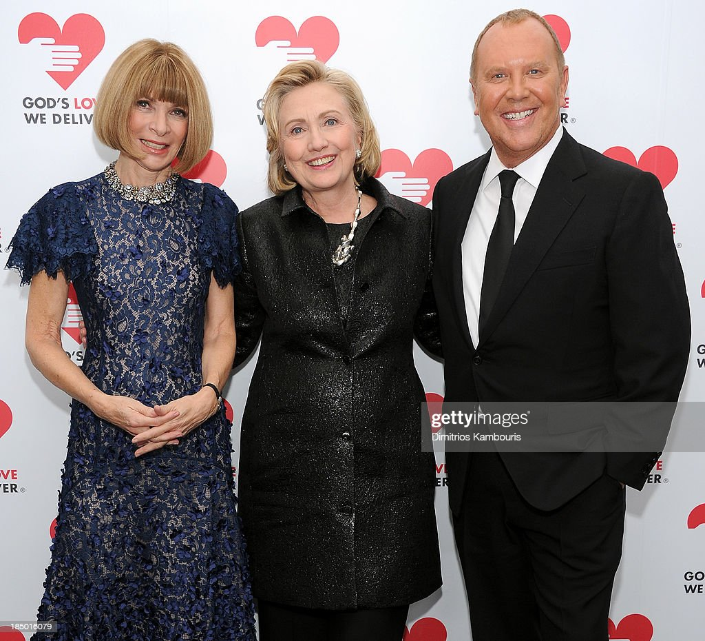 Vogue editor-in-chief <a gi-track='captionPersonalityLinkClicked' href=/galleries/search?phrase=Anna+Wintour&family=editorial&specificpeople=202210 ng-click='$event.stopPropagation()'>Anna Wintour</a>, Hillary Rodham Clinton, recipient of the <a gi-track='captionPersonalityLinkClicked' href=/galleries/search?phrase=Michael+Kors+-+Fashion+Designer&family=editorial&specificpeople=4289231 ng-click='$event.stopPropagation()'>Michael Kors</a> Award for Outstanding Community Service, and Designer <a gi-track='captionPersonalityLinkClicked' href=/galleries/search?phrase=Michael+Kors+-+Fashion+Designer&family=editorial&specificpeople=4289231 ng-click='$event.stopPropagation()'>Michael Kors</a> attend God's Love We Deliver 2013 Golden Heart Awards Celebration at Spring Studios on October 16, 2013 in New York City.