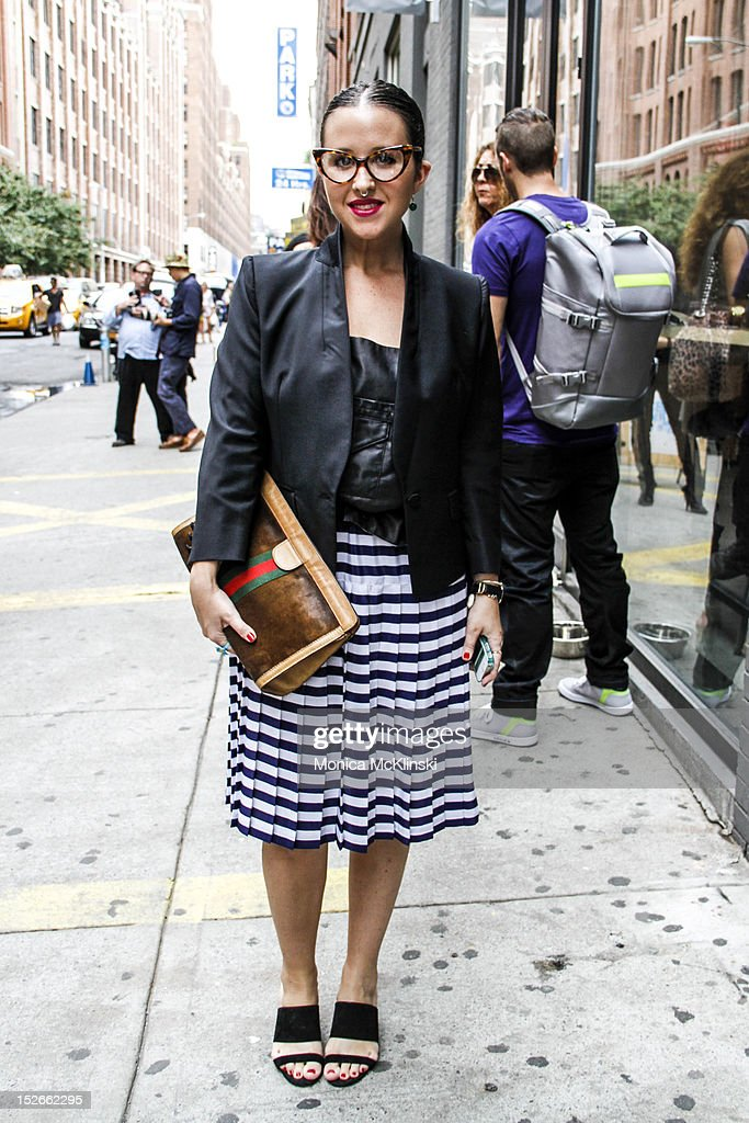 Vogue Illustrator Jessica Repetto seen wearing a Band of Outsiders jacket and vest, vintage skirt, Marc Jacobs shoes and Tom Ford eyeglasses outside the Costello Tagliapietra showing at Milk Studios at Streets of Manhattan on September 6, 2012 in New York City.