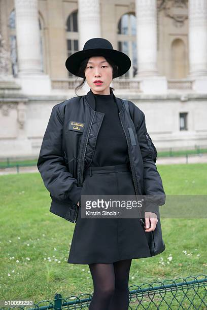 Vogue Korea Fashion writer Sun Jeong wears a Etudes Studio hat and bag The Simpson jacket and Carven skirt on day 3 of Paris Haute Couture Fashion...