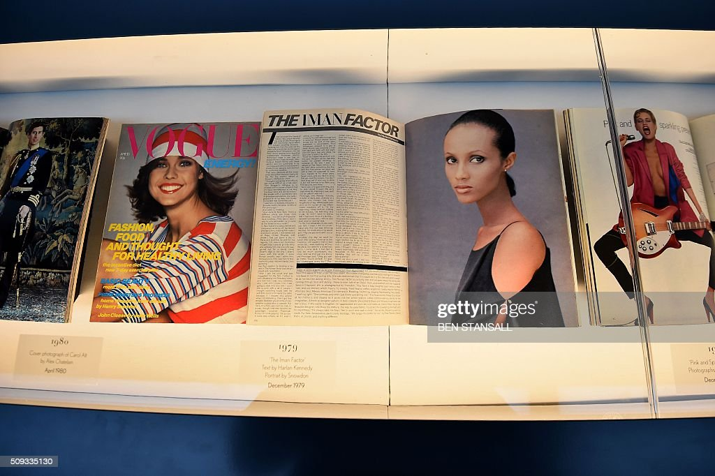 A Vogue magazine showing an image of Somali fashion model Iman taken by Snowden in 1979 is seen as part of the 'Vogue 100 a Century of Style' exhibition at the National Portrait Galley in central London on February 10, 2016. The exhibition showcases a range of photography commissioned by British Vogue since it was founded in 1916. / AFP / BEN STANSALL / RESTRICTED TO EDITORIAL USE - MANDATORY MENTION OF THE ARTIST UPON PUBLICATION - TO ILLUSTRATE THE EVENT AS SPECIFIED IN THE CAPTION