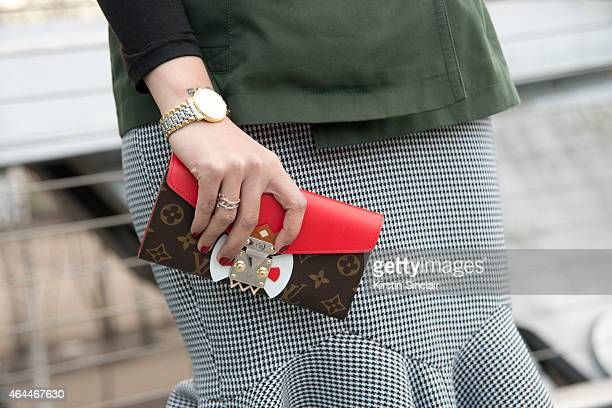 Vogue Thailand Deputy Editor Soraya Vattanajimwong wears a Burberry jacket Poem skirt and Luis Vuitton bag on day 4 of London Collections Women on...
