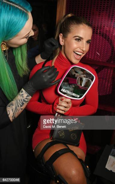Vogue Williams gets a piercing at Maybelline's Bring On The Night London Fashion Week party at The Scotch of St James on February 18 2017 in London...
