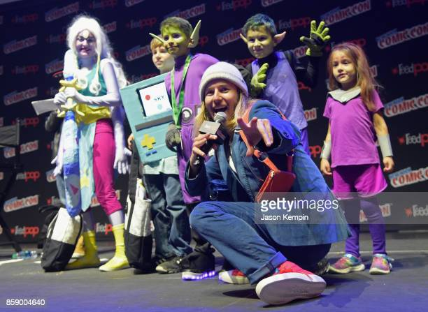 Voice actor Greg Cipes poses with fans participating in a costume contest during the Cartoon Network Costume Ball during New York Comic Con 2017 JK...