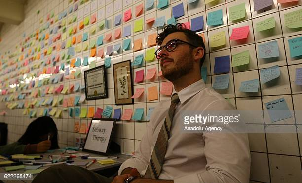 Voice Actor Matthew Chavez poses near his public art project named 'Subway Therapy' People as people write their messages on selfstick paper at the...